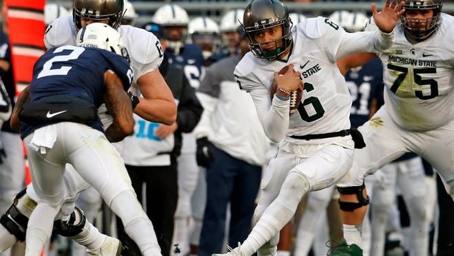 Michigan State junior quarterback Damion Terry (6) takes off running against Penn State during the first half Saturday. Terry completed 7 of 12 passes for more than 100 yards before being injured in the second quarter.