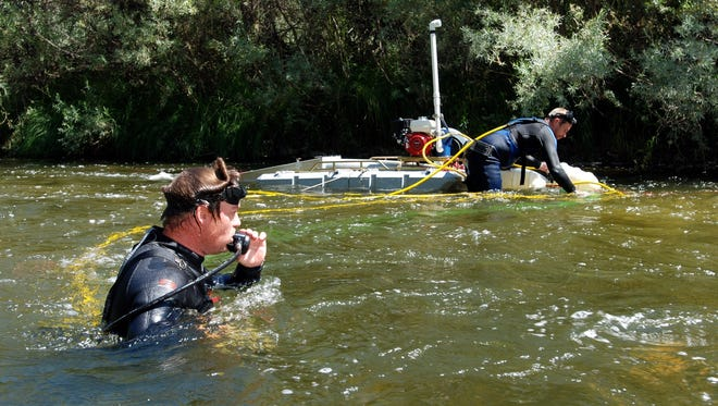 In this file photo, Aaron Webb of Rapids, Wis., (left) and Matt Lauer of Portage, Wis., team up to hunt for gold with a suction dredge on the Klamath River near Happy Camp, Calif.