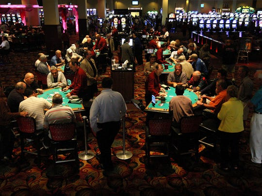 Patrons of the Seminole Casino in Immokalee, Fla., play blackjack on March 29, 2010.