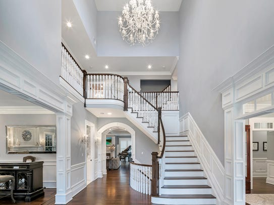 Step into the foyer that offers  an amazing Schonbek