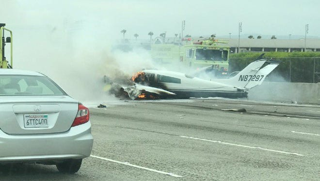 The plane that crash landed on the Santa Ana freeway seen from the dash of a vehicle driving.