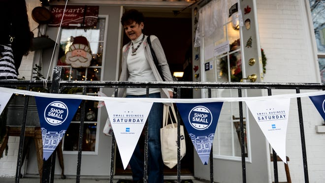 People leave Stewart's Peddler in Annville as people around the Lebanon Valley participated in Small Business Saturday on Saturday, November 28, 2015.