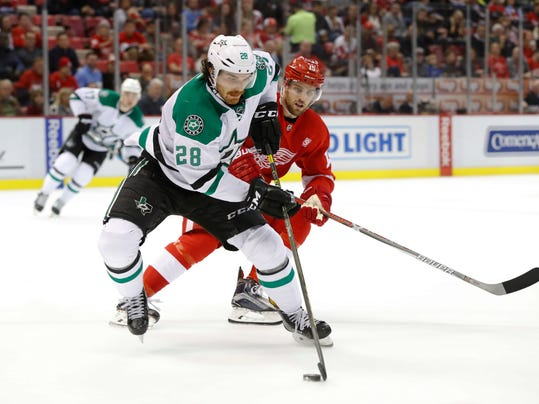 Dallas Stars defenseman Stephen Johns (28) skates with the puck as Detroit Red Wings center Riley Sheahan (15) defends in the second period of an NHL hockey game Tuesday, Nov. 29, 2016 in Detroit. (AP Photo/Paul Sancya)