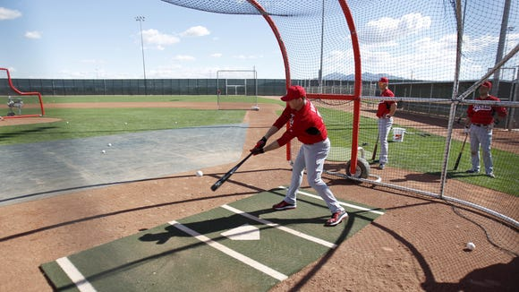 Reds right fielder Jay Bruce takes batting practice.