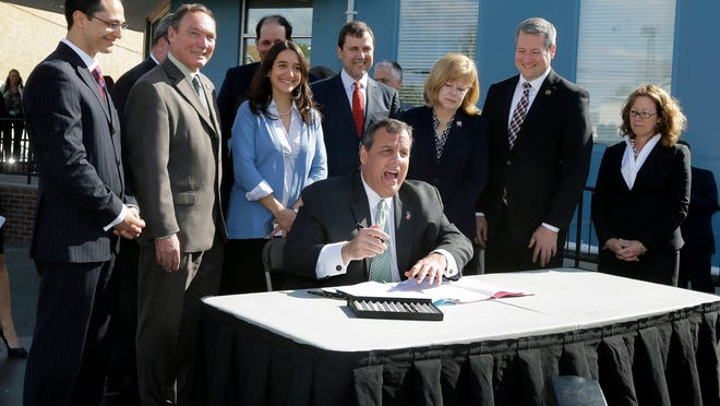 New Jersey Gov. Chris Christie shouts back at hecklers during an outdoor bill signing ceremony Wednesday in New Brunswick.
