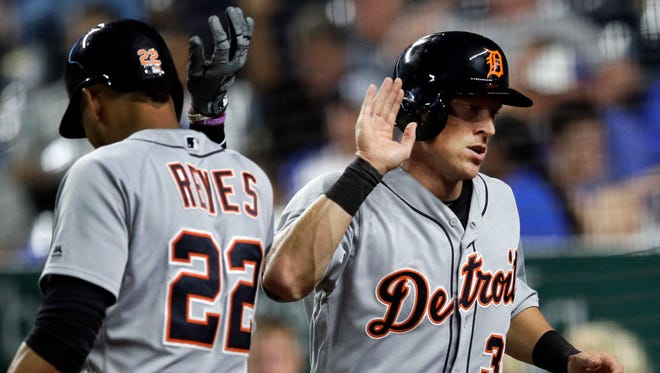 Detroit Tigers' Jim Adduci, right, is congratulated by teammate Victor Reyes after scoring the go-ahead run during the ninth inning on Monday night.