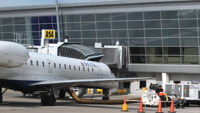 A Delta Connection jet sits at the Indianapolis International Airport terminal on Tuesday, Sept. 17, 2013. Charlie Nye / The Star.