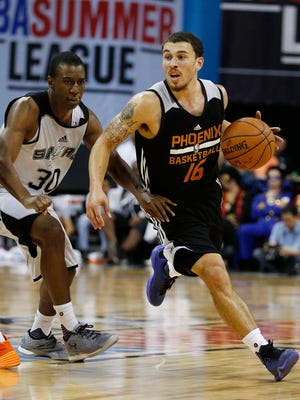 Phoenix Suns' Mike James, right, drives around San Antonio Spurs' Shannon Scott during the second half of an NBA summer league basketball game Monday, July 20, 2015, in Las Vegas.
