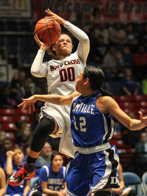 """Deja Turner goes up for two of her team-high 19 points in Holy Cross' All """"A"""" state tournament game against Danville on Wednesday."""