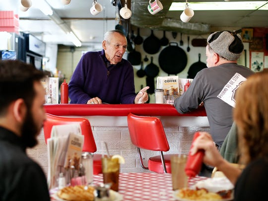 Anton's Coffee Shop owner Anton Tasich talks with Eric Wood, a regular costumer of the popular Springfield breakfast spot on Dec. 3, 2015. Tasich, who is originally from Omaha, Neb., has owned the coffee shop since 1974.