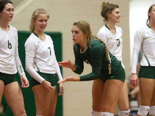 Lincoln's Callie Workman hypes up her team before their game against Wakulla at Lincoln High School on Tuesday.