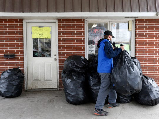 Ben Allen piles up bags of cans for sorting Thursday,