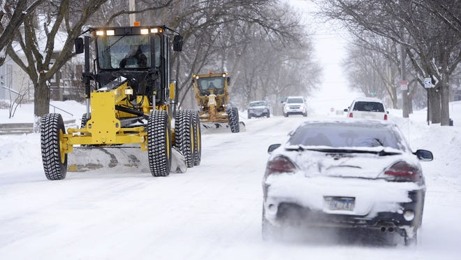 File photo of snowplows in Sioux Falls.