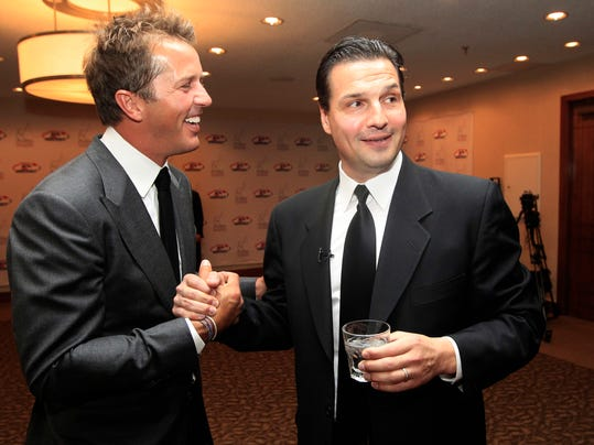 "FILE - In this Monday, Oct. 15, 2012, Hockey greats Eddie Olczyk, right, and Mike Modano shake hands and visit before the U.S. Hockey Hall of Fame class of 2012 induction dinner in Dallas. Former NHL forward and coach Eddie Olczyk has been diagnosed with colon cancer, Tuesday, Aug. 8, 2017. Olczyk, who turns 51 on Aug. 16, had surgery last week, and Blackhawks team physician Dr. Michael Terry says he ""will be undergoing further treatment in the coming weeks, including chemotherapy.""(AP Photo/LM Otero, File)"