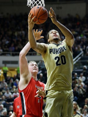 Purdue center A.J. Hammons (20) shoots over Youngstown State center Jorden Kaufman (32) in the second half of an NCAA college basketball game in West Lafayette, Ind., Saturday, Dec. 12, 2015. Purdue defeated Youngstown State 95-64. (AP Photo/Michael Conroy)