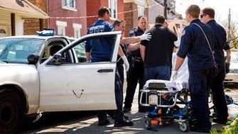 Covington paramedics prepare to take a revived overdose victim to St. Elizabeth Hospital.