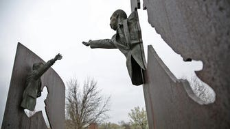 A statue depicts Martin Luther King Jr. and Bobby Kennedy at King Park in Indianapolis. Kennedy spoke at the park on the day that King was assassinated.