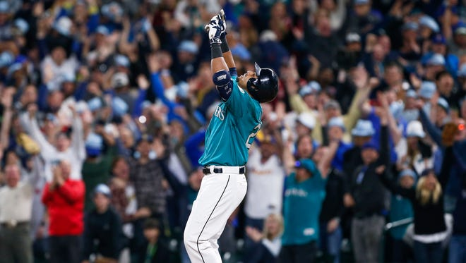 Mariners right fielder Nelson Cruz celebrates after his walk-off RBI-single against the Red Sox.