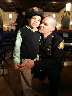 Yonkers police Detective Frank Fernandez with his son, David, at the Westchester County Law Enforcement Memorial Day Service and Awards Ceremony in 2009. Fernandez was killed early Sunday when the SUV he was driving struck a city fire truck.