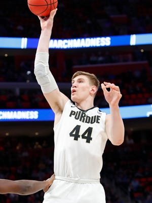 Mar 16, 2018; Detroit, MI, USA; Purdue Boilermakers center Isaac Haas (44) shoots in the second half against the Cal State Fullerton Titans in the first round of the 2018 NCAA Tournament at Little Caesars Arena. Rick Osentoski-USA TODAY Sports