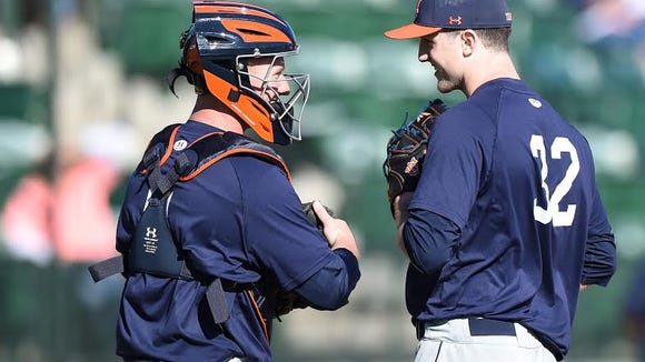 Auburn freshman reliever Casey Mize (32) going over signs with Auburn catcher Blake Logan in practice in Jan. 30.