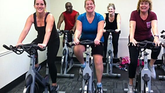 (Front row, from left) Andrea Ryan, Regina Messier and Mary Ann Lincks; and (back row, from left) Joe Brown and Maria Hensley participate in a turkey burner spin class at the YMCA of Vineland on Black Friday.