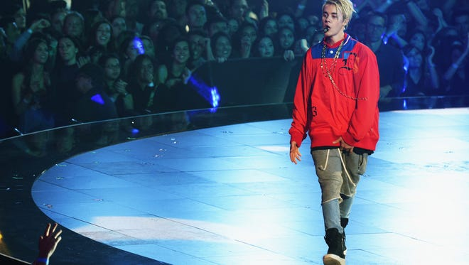Bieber, expertly staying upright on stage.