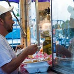 A guest buys a funnel cake from one of the many food vendors at Red, Hot and Boom, hosted by XL 106.7 FM and the City of Altamonte Springs, on Sunday, July 3.