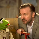 """Green and mean: Ricky Gervais with Kermit the frog in """"Muppets Most Wanted."""""""