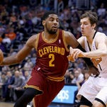 Cavaliers' guard Kyrie Irving dribbles past Goran Dragic during a March 12 game in Phoenix. The franchise will probably offer Irving a maximum contract this offseason. Will he accept it is the big question in Cleveland.