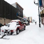 A City of Staunton snowplow drives along Lewis Street after a snowstorm accumulating over a foot of snow on Thursday, Feb. 13, 2014, in Staunton.