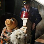 """Kermit the frog, left, and Ricky Gervais appear in a scene from """"Muppets Most Wanted."""""""