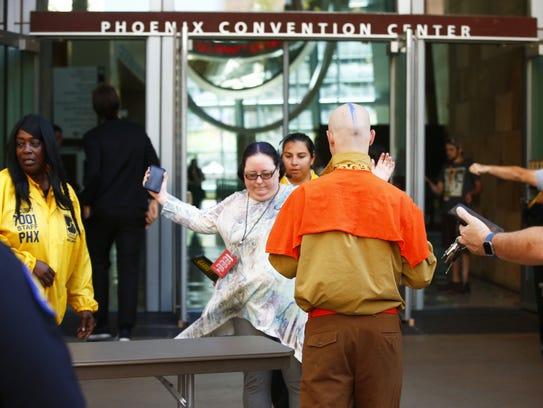 Security uses hand metal detectors to check Phoenix