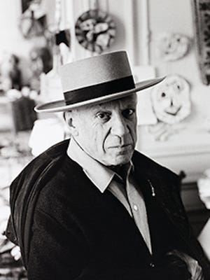 """""""Picasso in Cordoban hat and Spanish cloak,"""" 1957, by photographer David Douglas Duncan.  ©2016 Estate of Pablo Picasso/Artists Rights Society (ARS), New York"""
