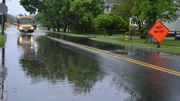 Downpours flood roads, cancel events