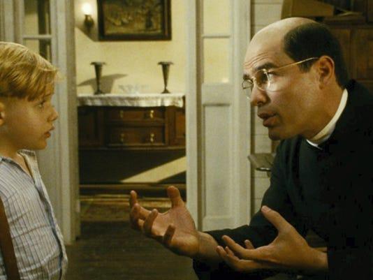 "Jakob Salvati as Pepper Flynt Busbee and Eduardo Verastegui as Father Crispin in ""Little Boy."""