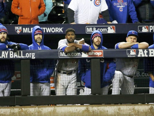 The Chicago Cubs bench watches during the ninth inning of Game 2 of the NLCS against the New York Mets on Sunday in New York. The Mets are ahead, 2-0, wit the teams playing Game 3 tonight in Chicago.