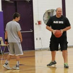 Dave Caldwell demonstrates a move at a Glen Este summer basketball camp. The veteran coach of the Trojans will become an assistant principal at Colerain Middle School.