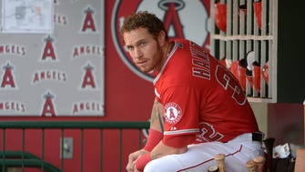 Josh Hamilton watches in the dugout during the game against the Rays at Angel Stadium.