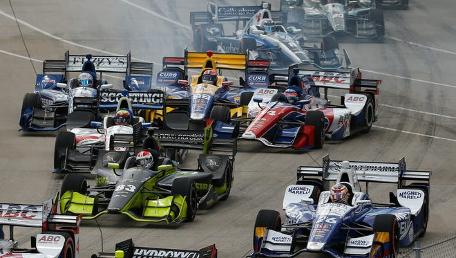 Takuma Sato (14) and Max Chilton (8) get sideways in Turn 1 on the opening lap during the second race  of the IndyCar Detroit Grand Prix  doubleheader on Belle Isle in Detroit on Sunday, June 5, 2016.