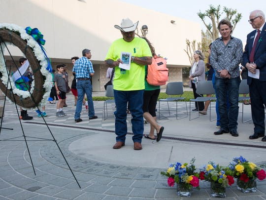Eloy Valenzuela, father of Natalie Kucera, looks at his daughter's engraved brick on Lee Plaza during the Islander Tribute ceremony. Texas A&M University-Corpus Christi students who died this past year were added to the Islander Tribute memorial during a ceremony Tuesday, April 4, 2017.