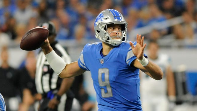 Detroit Lions quarterback Matthew Stafford passes during the first quarter against the Carolina Panthers, Sunday, Oct. 8, 2017 in Detroit.