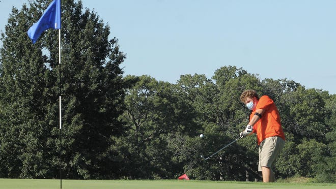 Kewanee's Walkyr Peed chips onto the green on the No. 7 hole on Wednesday at Baker Park.