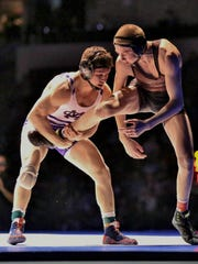 Mission Oak's Jaden Enriquez grabs Rancho Buena Vista's Bernie Truax in the 138-pound final on Saturday at the 45th annual CIF Boys Wrestling State Championships at Rabobank Arena in Bakersfield. Enriquez won by a 16-6 major decision.