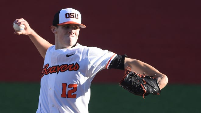 Oregon State's Sam Tweedt, from South Salem High School, pitches as the Beavers take on Oregon on Tuesday, May 5, 2015. Tweedt and the Beavers are currently in the College World Series, one win away from the finals.
