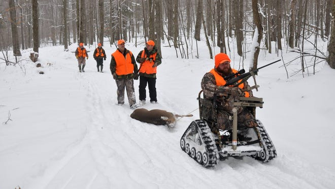 Dennis Leonard of Middletown drags a deer out of the woods during a hunt with LEEK.