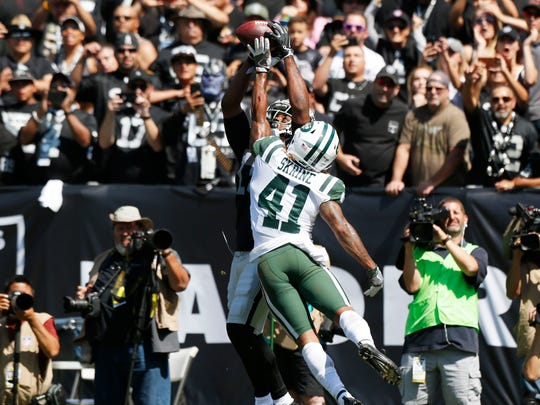 Raiders receiver Michael Crabtree (15) makes a leaping