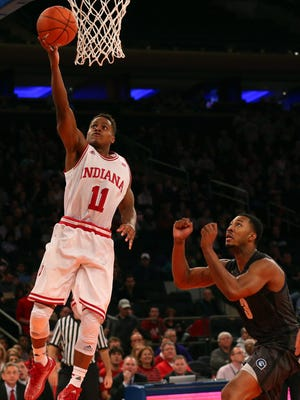 Dec 27, 2014; New York, NY, USA;  Indiana Hoosiers guard Yogi Ferrell (11) shoots during the second half against the Georgetown Hoyas at Madison Square Garden. Georgetown Hoyas won in overtime 91-87. Mandatory Credit: Anthony Gruppuso-USA TODAY Sports