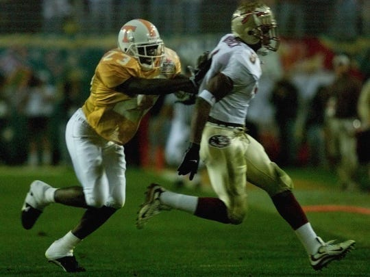 Tennessee's Dwayne Goodrich works against FSU's Peter Warrick during the first quarter of the Fiesta Bowl on Jan. 4, 1999.