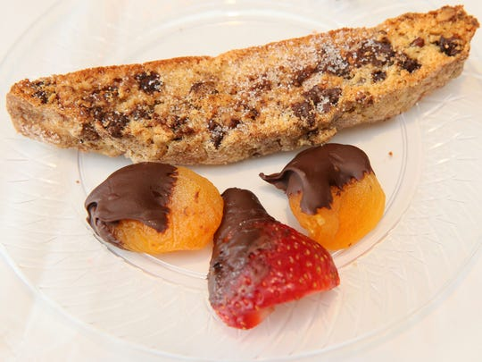 This mandelbread, served here with chocolate-coated dried apricots and strawberry, is chock-full of chocolate chips and coated with cinnamon sugar.